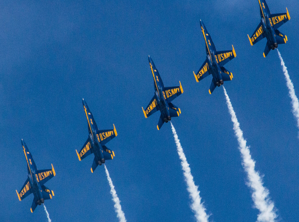 Blue Angels jets flying in  a row