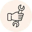 Circular icon with a photo of a hand holding a wrench